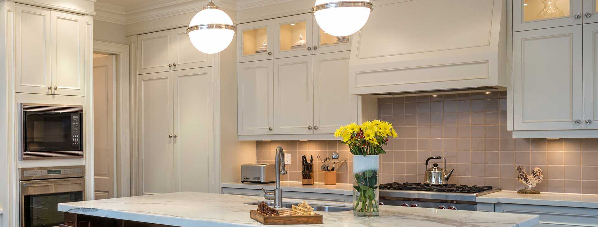 Beautiful white kitchen with traditional forever cabinet door and drawer fronts